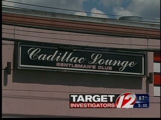 Cadillac lounge strip club touching phrase