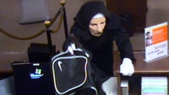 ap nuns robbery nt 110531 wg Woman Robs Bank Wearing Nun's Habit