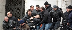 Bodyguards carry Zlatomir Ivanov, after he was shot in front of central court house in downtown Sofia, Tuesday, Jan. 29, 2013. (AP Photo)