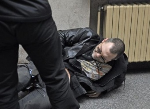 Ivanov is pictured here lying helpless on the floor inside Sofia courthouse after he was shot and seriously wounded in broad daylight while going to its entrance. Photo by Sofia Photo Agency