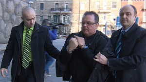 Raynald Desjardins is escorted into SQ headquarters in December of 2011 after his arrest in connection with shooting death a month earlier of Salvatore Montagna. Police said Montagna was attempting to take over the mafia in Montreal. With the return of reputed mobster Vito Rizzuto to Montreal last October, it seems anyone who had plans to take over the local mob has been obliged to re-think them. (Video still courtesy of RADIO-CANADA)