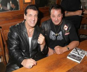 Kevin Lubic pictured right), wearing his Hells Angels regalia, is shown at a party with actor Chuck Zito  in New York Sept. 24, 2009