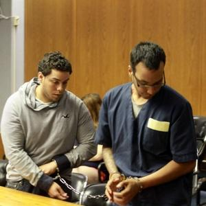 SHACKLED: Raul Pacheco (left) and Eric Landron, charged with the murder of Alphonza Bryant, in Rhode Island court yesterday