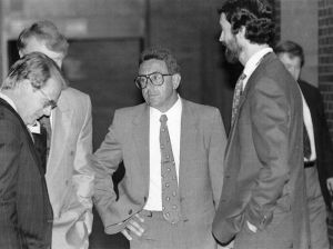 "05.22.1993 | Republican file photo | Springfield, MA, May 3, 1993, Adolfo ""Big Al"" Bruno (center) talks with attorneys in the hallway of the Hampden County Superior Court during a recess in his trial for attempted murder."