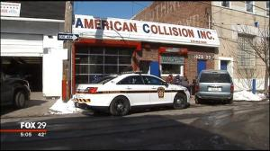 the District Attorney's Office carted away boxes of evidence from American Collision on South 20th Street and several homes in the exclusive Girard Estates section of South Philadelphia.