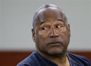 FILE - This May 13, 2013 file photo shows O.J. Simpson during an evidentiary hearing in Clark County District Court in Las Vegas. Simpson's lawyers submitted a supersized appeal May 21,