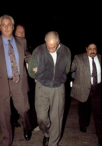Bartolomeo Vernace, seen here taken into custody, was convicted in 2013 of killing two men in a Queens bar in 1981. The