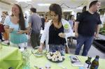 In this Thursday, July 10, 2014, photo, students taste a cannabis-infused dipping sauce prepared during a cooking class at the New England Grass Roots Institute in Quincy, Mas