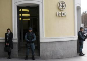 Spanish Civil Guard officers stand in front of the entrance of the headquarters of Industrial and Commercial Bank of China during a raid in Madrid